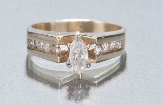 19: 14KT diamond solitaire ring.