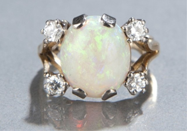 20: Opal and diamond ring.