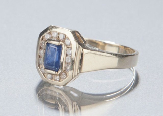 22: 14KT gold sapphire and diamond ring.