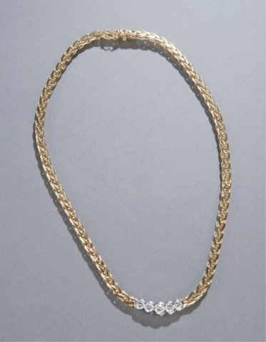 23: 18KT gold & diamond necklace.