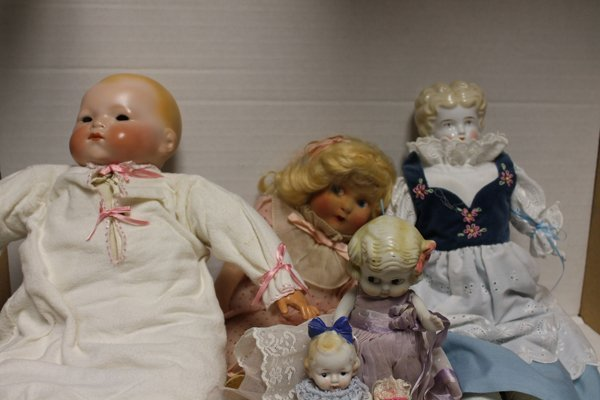 Group of 7 dolls incl Greiner style doll with porcelain