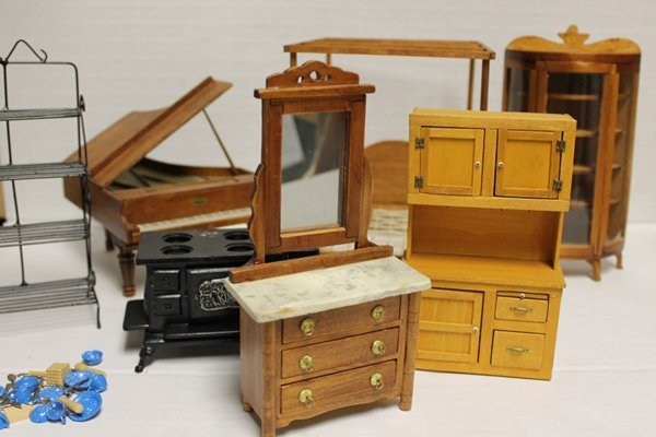 Group of wooden doll furniture incl piano, bed, etagere