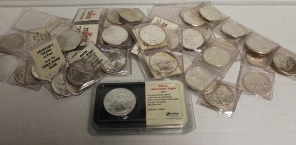 42 Silver American Eagle dollars 1 oz fine silver.