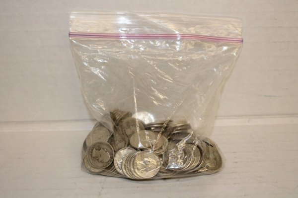 Group of over 150 silver quarters.