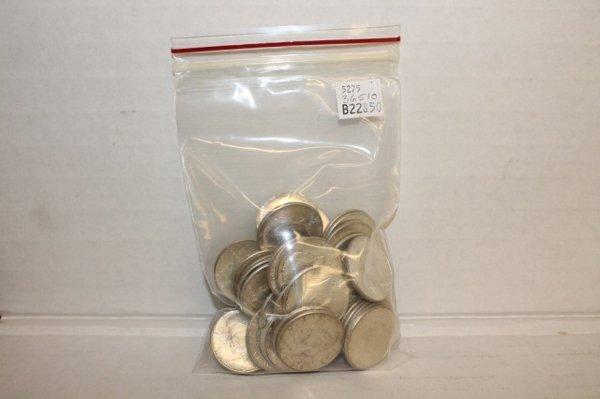 60 1964 Kennedy half dollar silver coins.