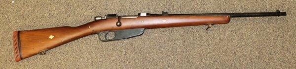 Italian Carcano 6.5 caliber bolt action rifle.