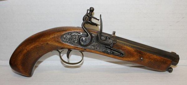 Replica flintlock pistol.