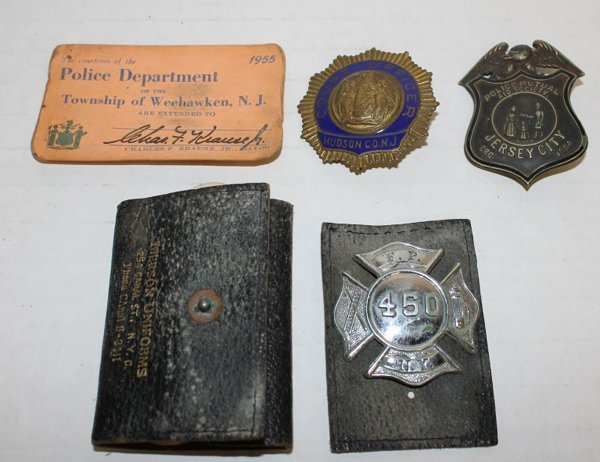 Group of vintage fire fighter and police badges.