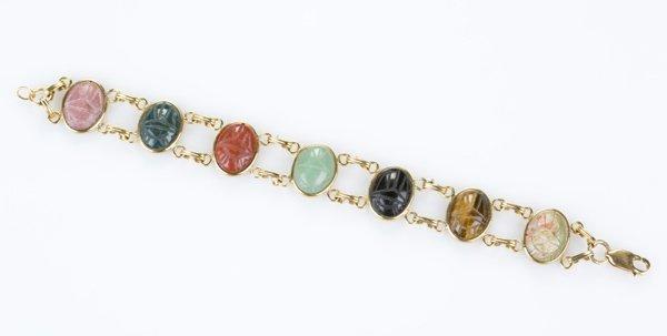Gold filled scarab bracelet w/ 7 stones.
