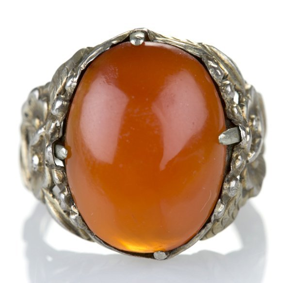 Silver floral band ring set w/ oval carnelian.