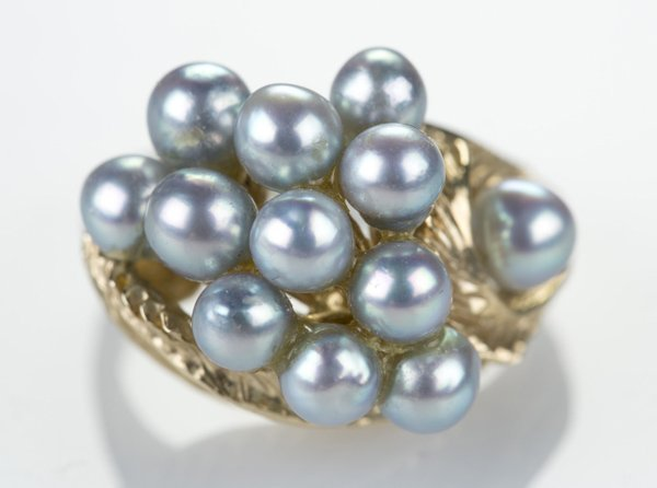 14 KT gold ring with grey pearls.