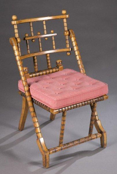 A George Hunzinger chair, walnut, stamped