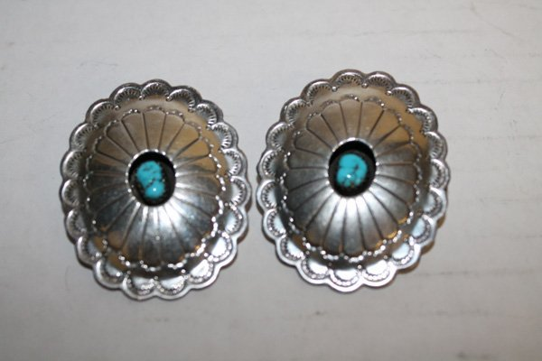 Pair of sterling silver, turquoise oval earrings.