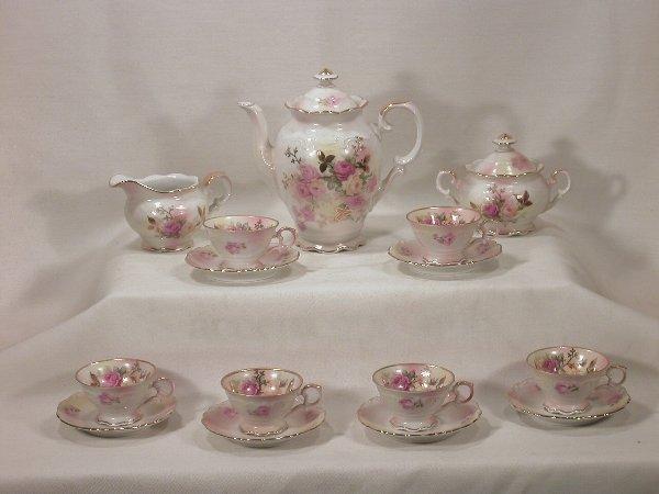 "7: German porcelain ""Sunset Rose"" coffee set"