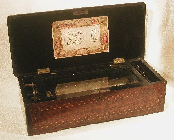 "9: Music box in inlaid rosewood case, 10 7/8"""
