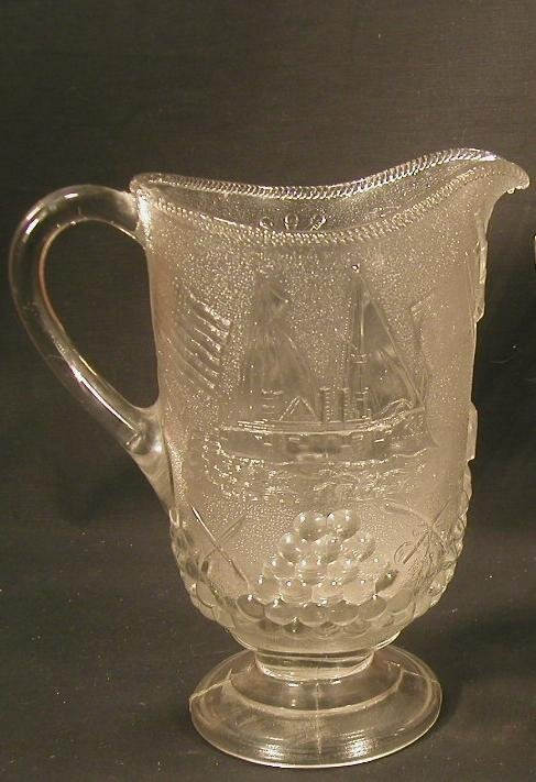 21: Two pattern glass pitchers with military