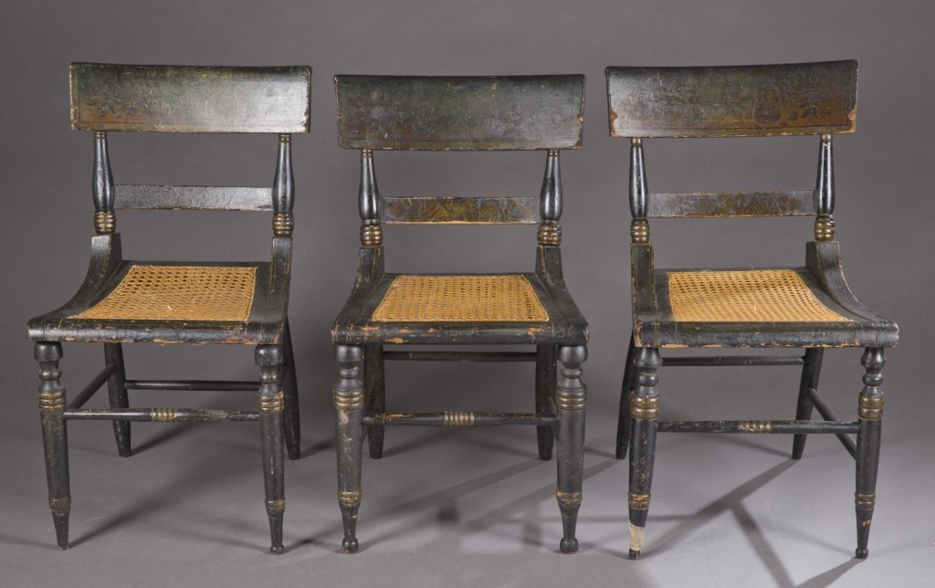 Group of 7 black painted cane fancy chairs.