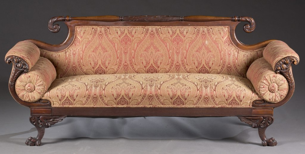 Empire style sofa w/carved details.
