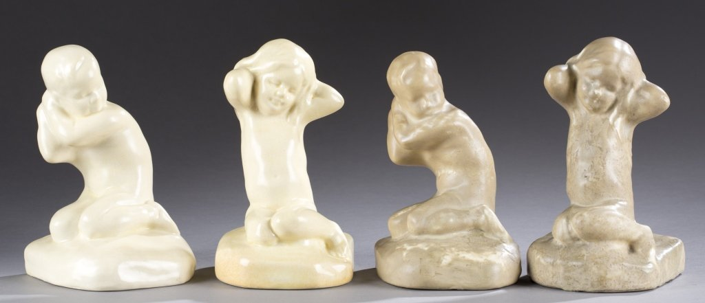 A Cowan Pottery pair of  boy and girl bookends.
