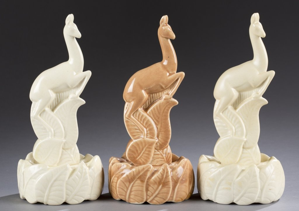 A Cowan Pottery group of three stag  flower  figures by