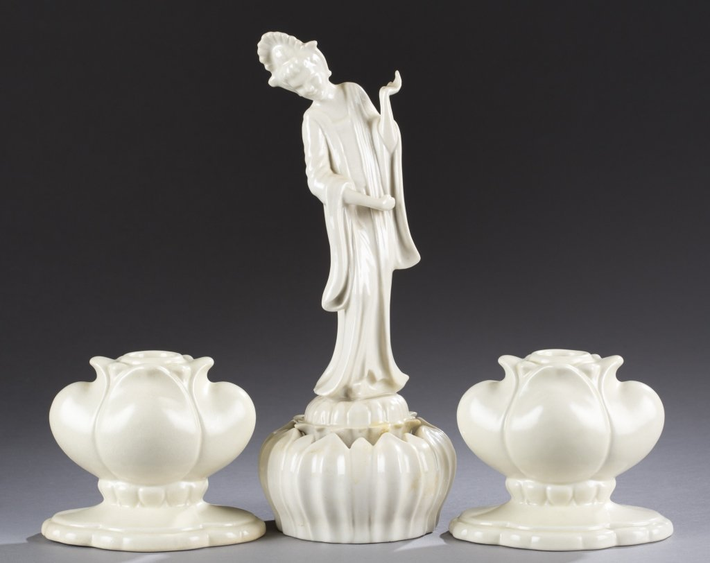 A Cowan Pottery oriental figure on lotus and two