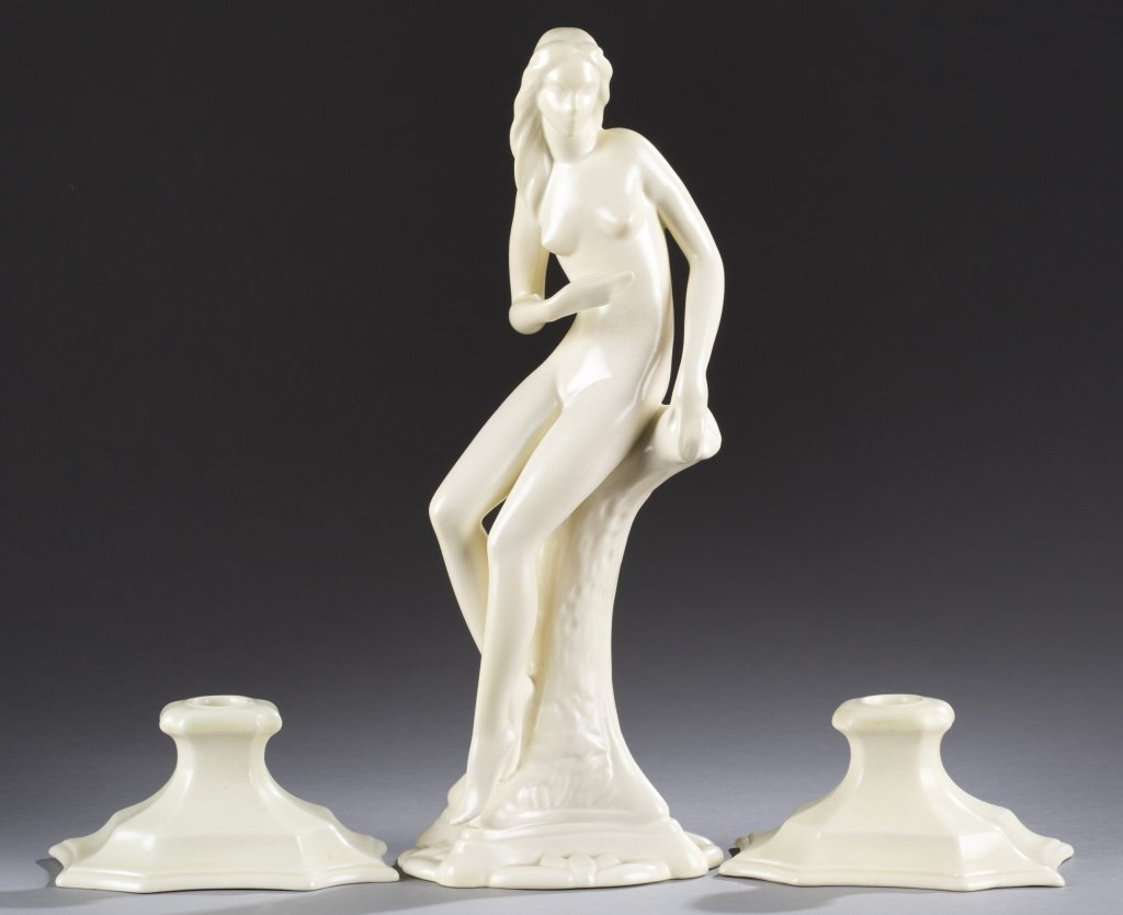 A Cowan Pottery Woodland Nymph with two  candlestick