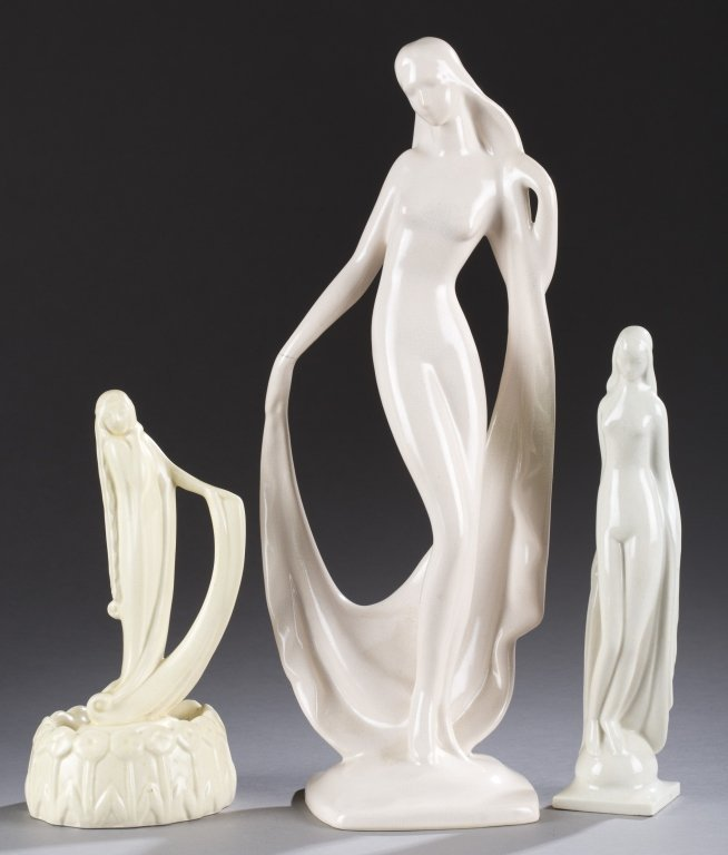 A Cowan Pottery group of three lady flower figures  by