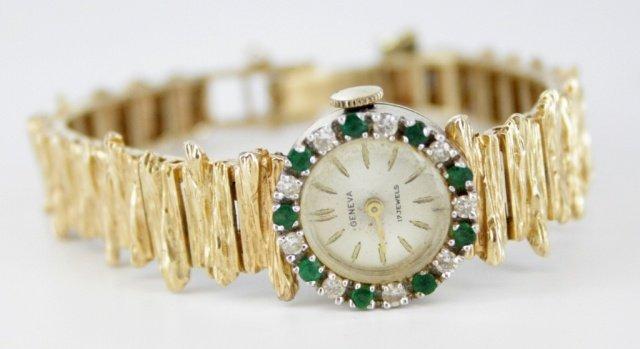 Ladies Geneve emerald, diamond, and 14kt watch.