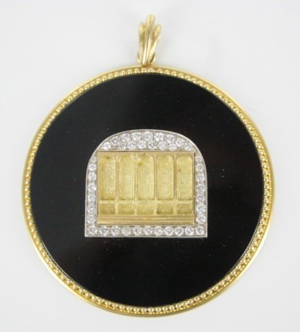 18kt gold plated diamond pendent back on glass.