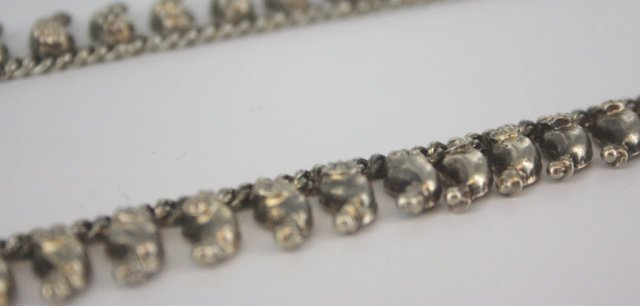 A silver pepper necklace.