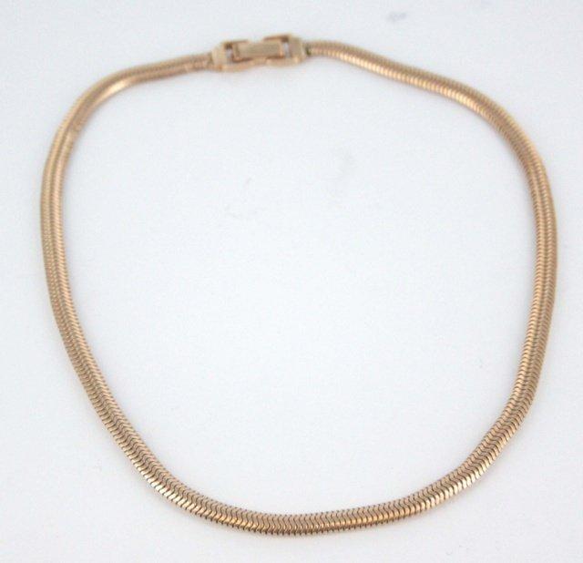 14kt rose gold omega style necklace.