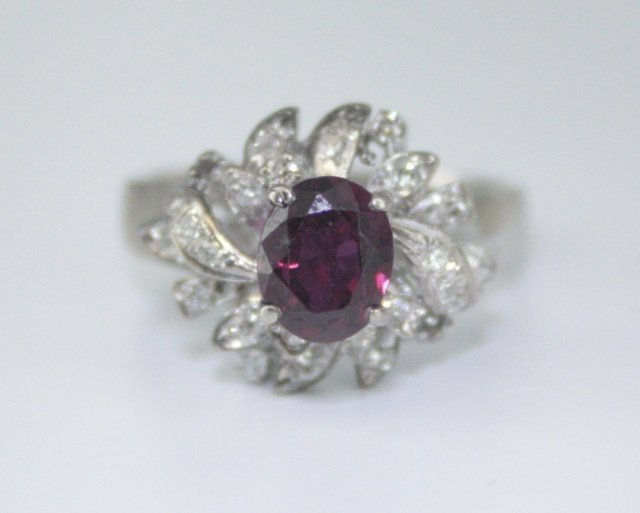 A diamond and ruby ring.