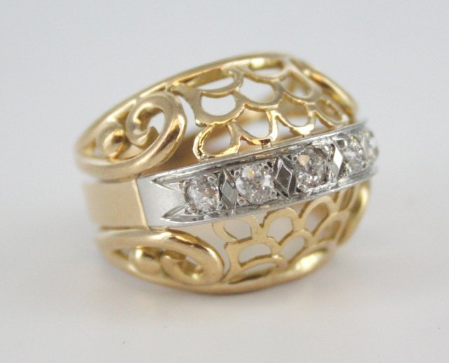 One 14kt gold and European cut diamond ring.