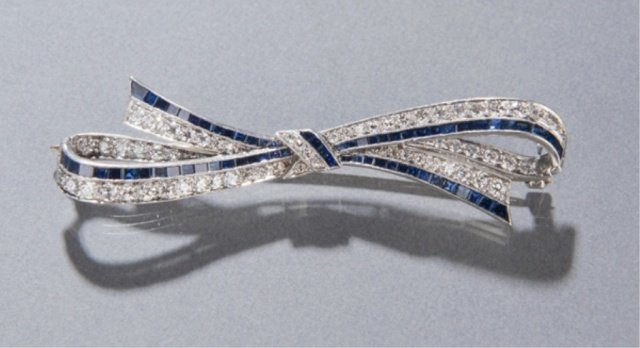 A sapphire and diamond bow brooch.