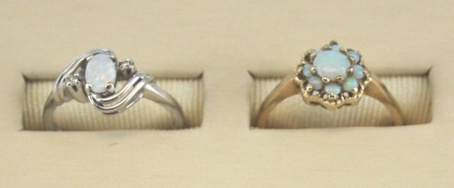 Pair of Opal 10kt gold rings.