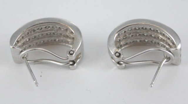 Pair of diamond and white gold huggy earrings.