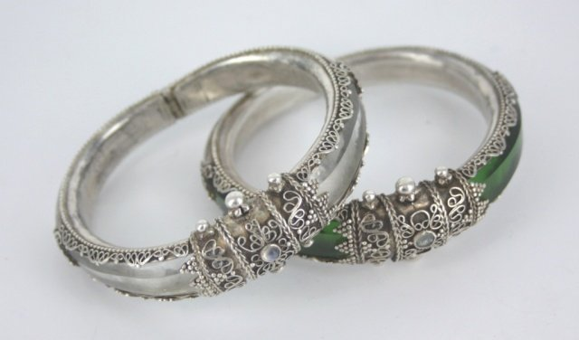 Lot of two hand made Asian silver bangles.