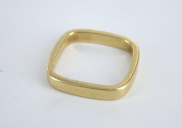 One tiffany & co 18kt gold mens square ring.