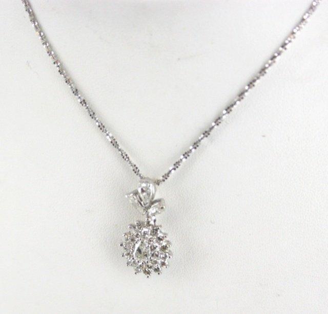 Ladies diamond cluster pendant.