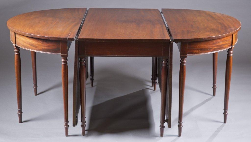 George III style mahogany three-part dining table.