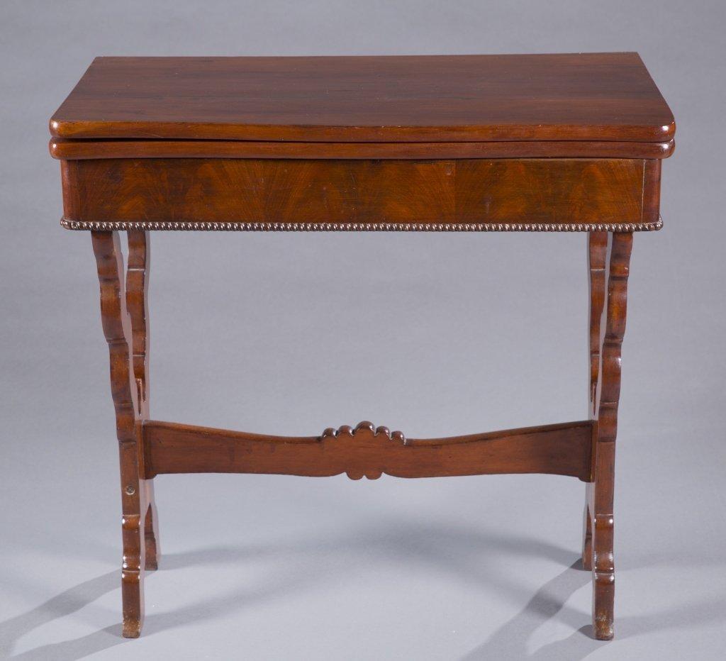 A mahogany flip top side table.