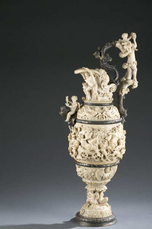 German, 19th c. silver and carved ivory ewer.