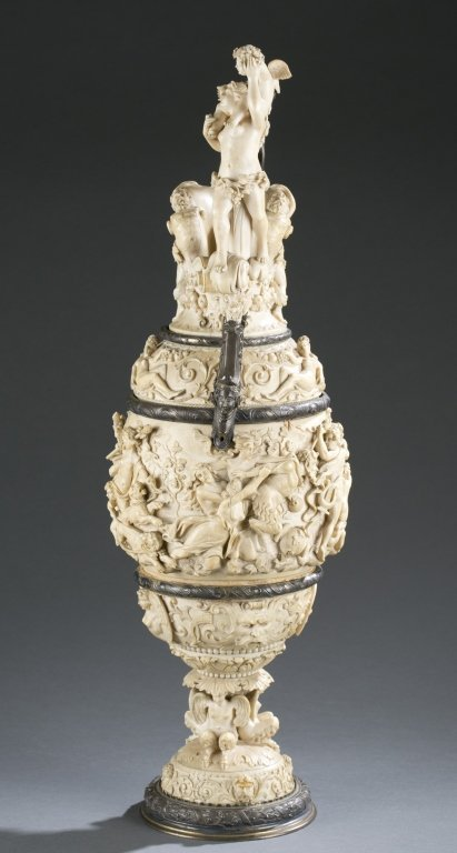 German, 19th c. silver and carved ivory ewer. - 2