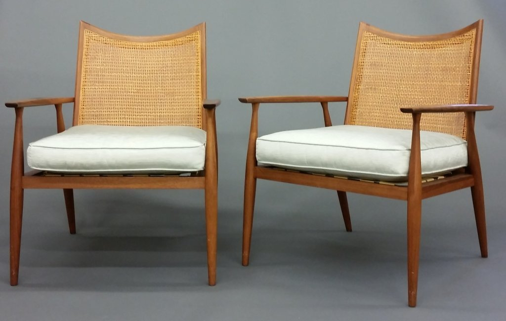 A pair of Danish Mid Century Modern lounge chairs.