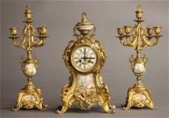 L. Marti French Rococo Revival garniture set.