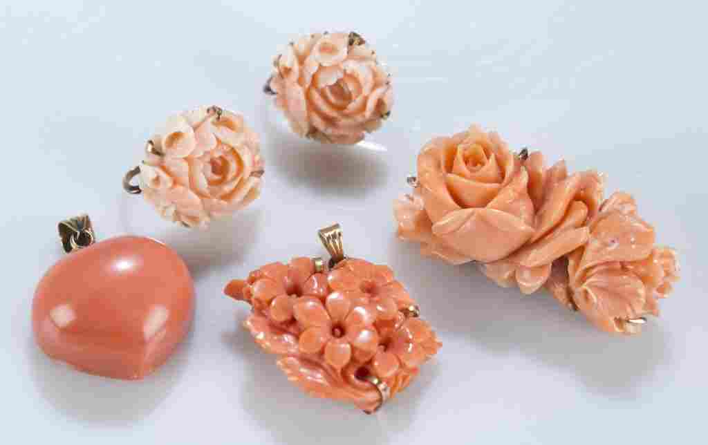 Group of carved coral jewelry.