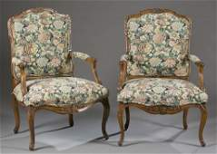 Pair of Louis XV style carved wood armchairs.