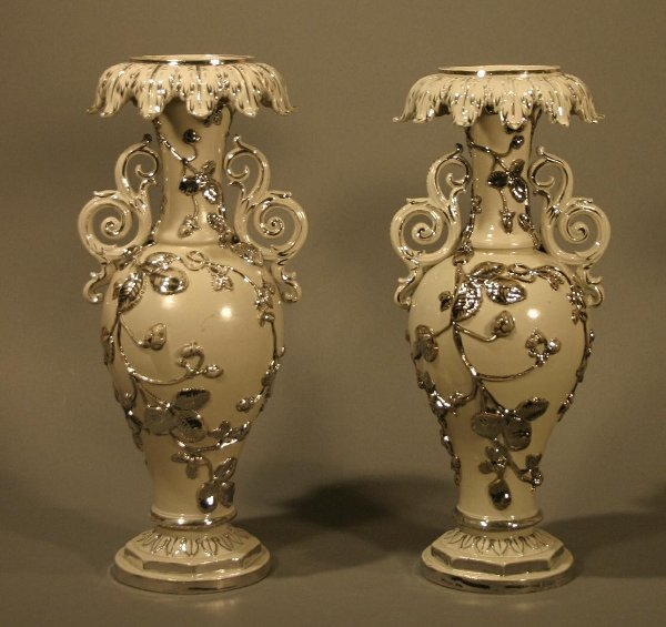 003: Pair of soft paste early 20th century vases.