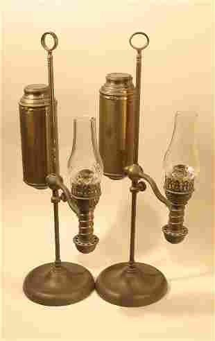011: Pair of brass single arm student lamps