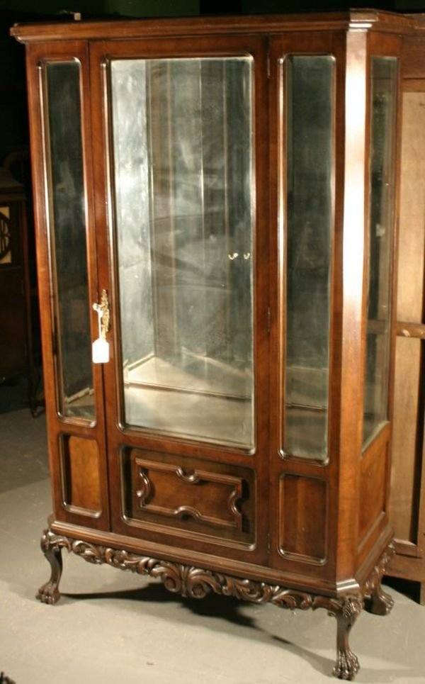 013: Walnut display cabinet with single beveled glass d